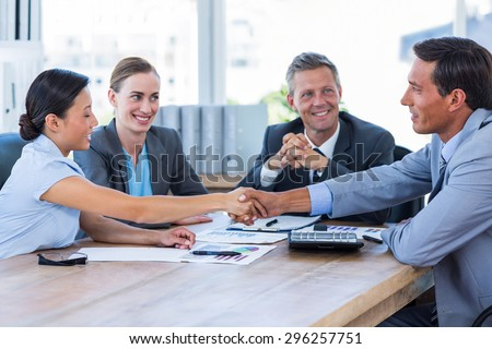 Business people shaking hands during meeting in office - stock photo