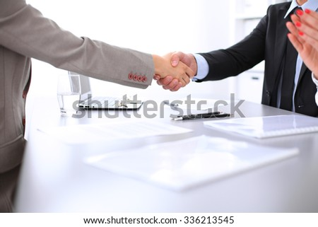 Business people shaking hands, finishing up a meeting. Copy space  at the left corner - stock photo