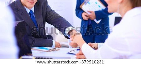 Business people shaking hands, finishing up a meeting, in office - stock photo