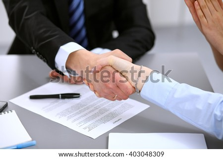 Business people shaking hands , finishing up a meeting to sign a new contract - stock photo