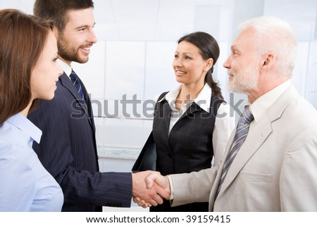Business people shaking hands in a modern office centre