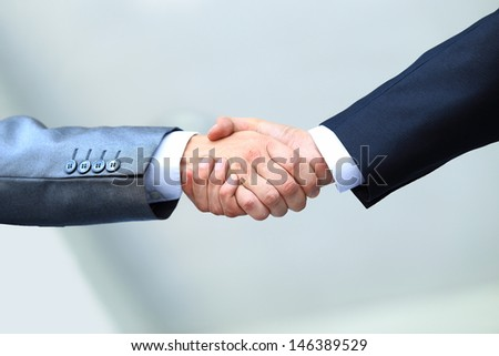 business people shaking hands in office - stock photo
