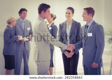 Business people shaking hands in the meeting room - stock photo