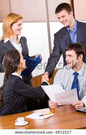 Business people shaking hands in the room - stock photo