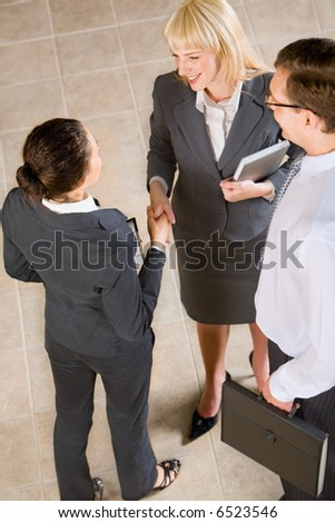 Business people shaking hands making an agreement - stock photo
