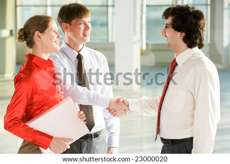 Business people shaking hands making an agreement at meeting - stock photo