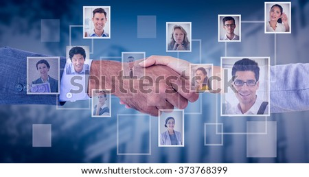 Business people shaking hands on white background against blue background with vignette
