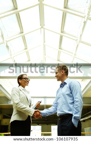 Business people shaking hands with a smile concluding a deal or greeting each other - stock photo