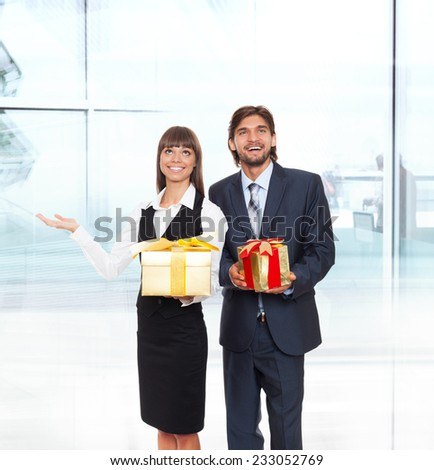Business people show open palm side empty copy space, businesswomen businessmen happy smile hold present gift red box in hand modern office background - stock photo