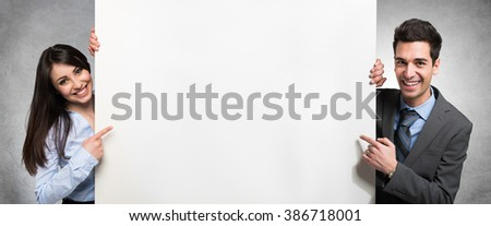 Business people showing an empty banner - stock photo