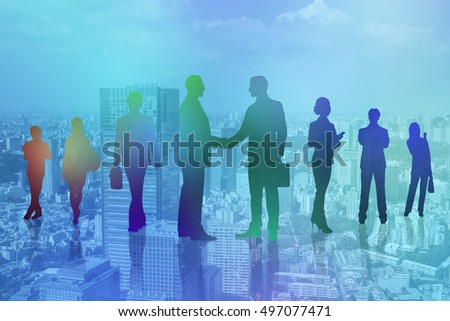 business people silhouettes on modern cityscape