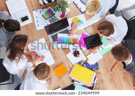 Business people sitting and discussing at business meeting - stock photo