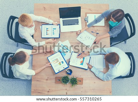 Business people sitting and discussing at meeting, in office