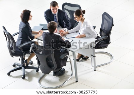 Business people sitting at a table for meeting - stock photo