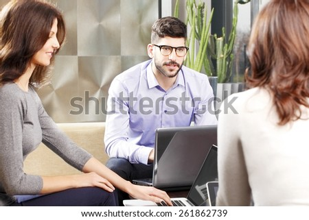 Business people sitting at business meeting at working on presentation at laptop. Teamwork.  - stock photo