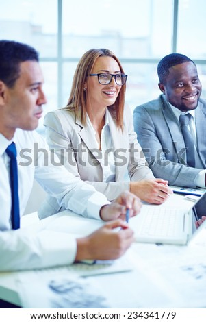Business people sitting at conference - stock photo