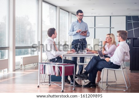 Business people sitting at corporate meeting - stock photo