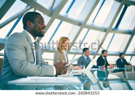 Business people sitting at meeting - stock photo