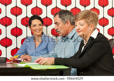 Business people sitting at meeting table and having conversation - stock photo