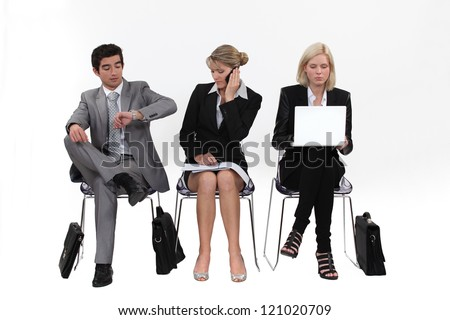 Business people sitting in a row - stock photo