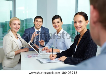 Business people sitting in boarding room and communicating - stock photo
