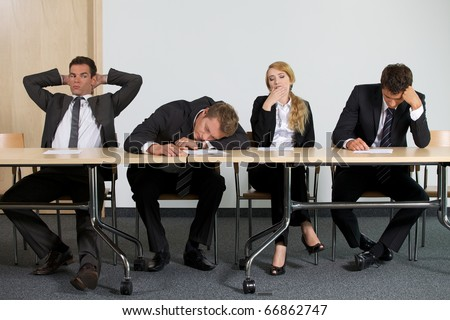 Business people sitting in office - stock photo