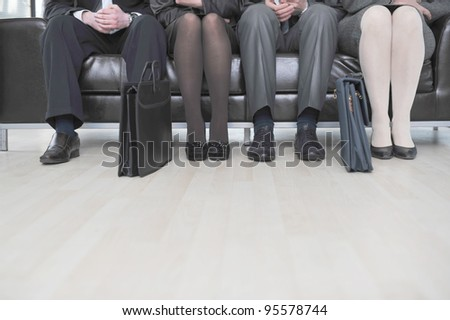 Business people sitting on couch - stock photo