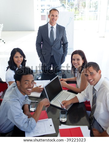 Business people smiling at the camera in a meeting - stock photo