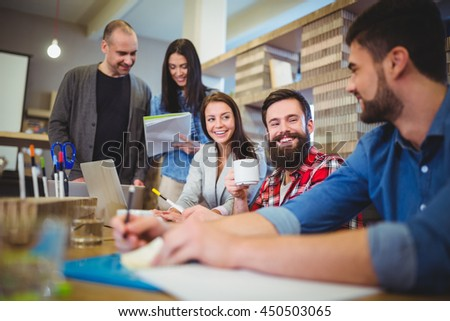 Business people smiling during meeting in creative office
