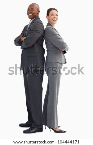 Business people smiling with their hands crossed - stock photo