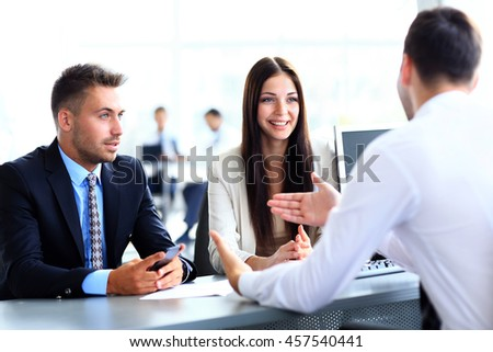 Business people speaking during interview in their office