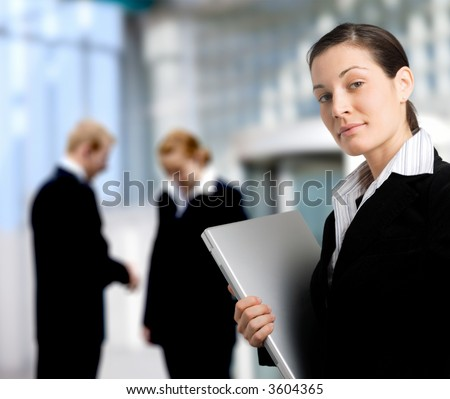 Business people stand in front of an office building. - stock photo