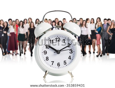 Business people stand near big alarm clock isolated on white