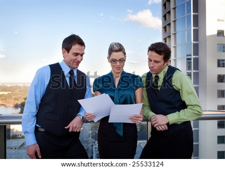 Business people standing an discussing a project - stock photo
