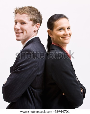 Business people standing back to back - stock photo