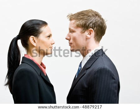 Business people standing face to face - stock photo