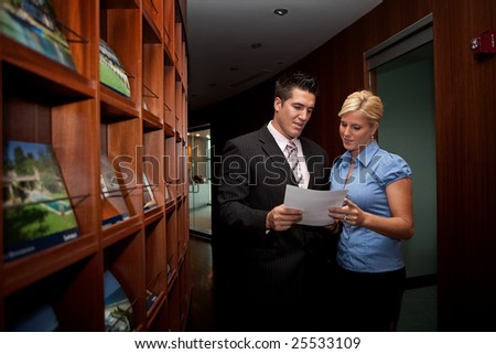 Business people standing in a hallway in an office - stock photo