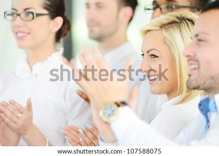 Business people standing in a row and applauding - stock photo