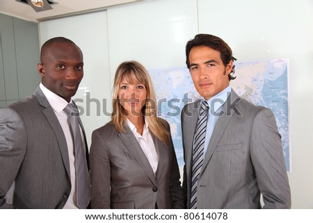 Business people standing in office - stock photo