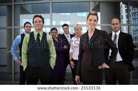 Business people standing, looking into camera - stock photo