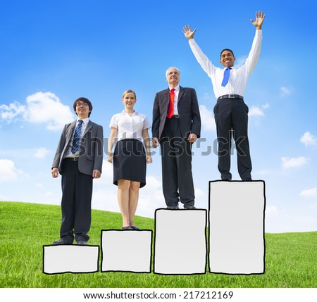 Business People Standing on a Bar Graph and Winning Concepts - stock photo