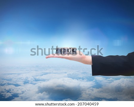 Business people standing up against blue sky over clouds at high altitude - stock photo