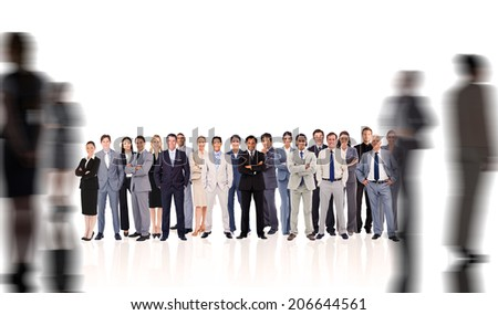 Business people standing up with silhouettes of business people - stock photo