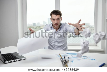 business, people, stress, emotions and fail concept - angry businessman throwing papers in office
