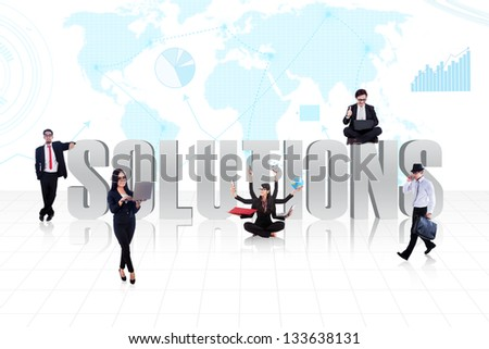 Business people surround the word SOLUTIONS on world map background - stock photo