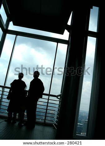 business people taking a break in a high building - stock photo
