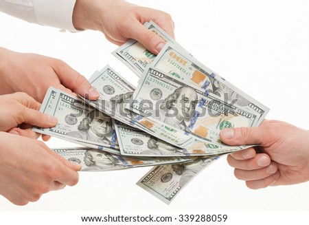 Business people taking money from businessman's hand, white background