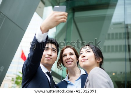 Business people taking self photo together - stock photo