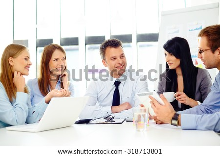 Business people talking during corporate meeting