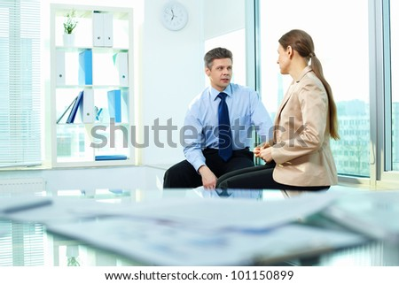 Business people talking in the middle of the workday - stock photo